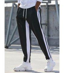 basics koyye pantalones de chándal cónicos casuales con rayas laterales para hombre