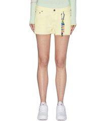 keyring spray paint denim shorts