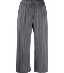 issey miyake micro-pleated cropped trousers - grey