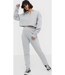 missguided zip front slim line joggers set jumpsuits