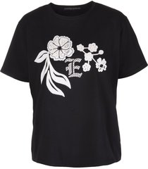 black t-shirt with embroidered floral inlays