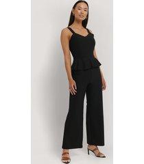 na-kd party frill waist jumpsuit - black