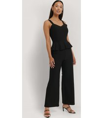 na-kd party frill waist jumpsuit - black