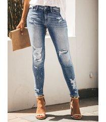denim rasgado al azar azul jeans