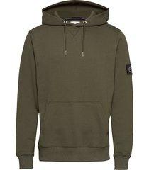 monogram sleeve badg hoodie grön calvin klein jeans