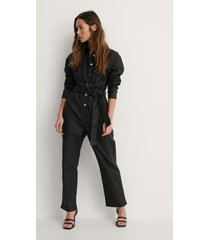 na-kd coatad denimjumpsuit - black