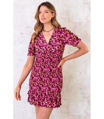 smocked jurk met bloemen fuchsia