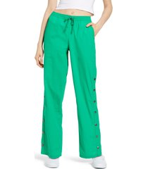 men's bp. be proud by bp. gender inclusive woven track pants, size x-small - green