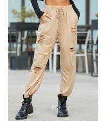 pantalones con bolsillos laterales yoins detalles rotos al azar