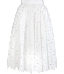 woman white bell skirt with cut-out flowers