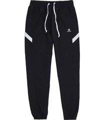 pantalón negro converse woven warm-up