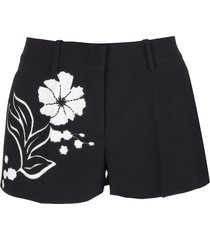 black shorts with embroidered floral inlays