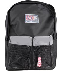 black techinc backpack with silver details