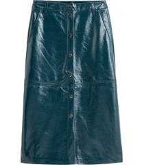 kjol i skinnimitation med tryckknappar fram