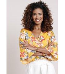 blusa feminina blusê transpassada estampada floral manga 3/4 decote v mostarda