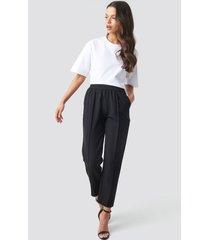 na-kd elastic waist seamline pants - black