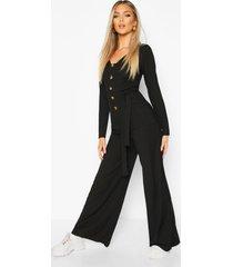 geribbelde jumpsuit met lange mouwen, hoornen knopen en strik, zwart