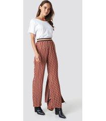 na-kd elastic waist printed pants - multicolor