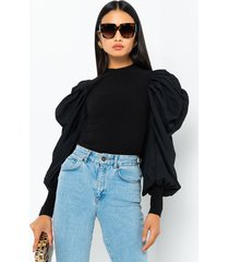 akira everything in long puff sleeve knit top