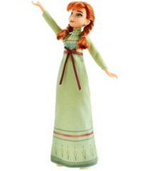 disney frozen arendelle fashions anna fashion doll with 2 outfits, green nightgown and white dress inspired by disney's frozen 2 movie