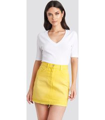 na-kd high waist denim mini skirt - yellow