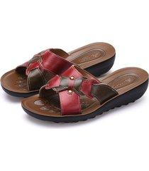 sandali piatti con bottoni in pelle con fiocco