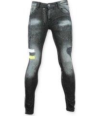 skinny jeans justing spijkerbroek verfvlekken