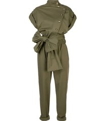 olive-green jumpsuit