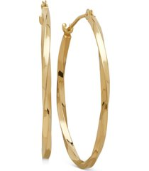 thin twist oval hoop earrings in 10k gold, 1 inch