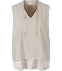 top with a metallic detail