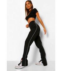 toelopende broek met contrasterende biezen en voorsplit, zwart