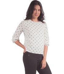 blusa adrissa blanca con puntos negros y detalle anudado en la espalda