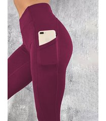 leggings de cintura alta con bolsillos laterales rojos yoins basics
