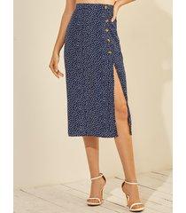 botón azul marino diseño falda con dobladillo con aberturas onduladas