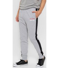 pantalón gris converse all star lateral stripe