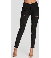 detalles rasgados al azar negros skinny jeans