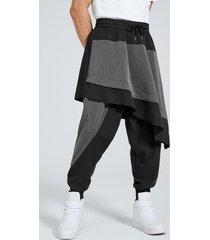 hombres japón streetwear hip hop color block empalme diseño escalonado pantalones harem