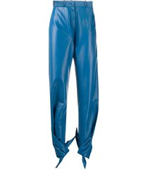 matériel tied-hem high-rise coated trousers - blue