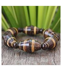 coconut shell and wood stretch bracelet, 'cocoa spin' (thailand)