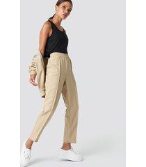 na-kd elastic waist seamline pants - beige