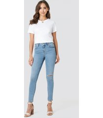 na-kd low rise distressed skinny jeans - blue