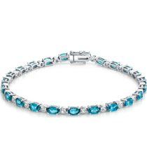 peridot (6-9/10 ct. t.w.) & white topaz (7/8 ct. t.w.) tennis bracelet in sterling silver (also available in blue topaz, opal and aquamarine)