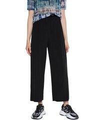 pantalón negro desigual