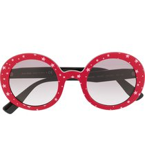 miu miu eyewear circle frame star print sunglasses - red