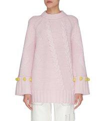 pom pom cuff oversized cable knit sweater