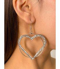 aretes de plata con diamantes en forma de corazón geométrico hueco