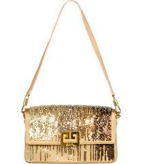 gold charm shoulder bag