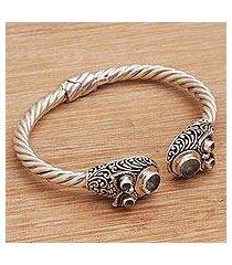 blue topaz cuff bracelet, 'wandering eyes' (indonesia)