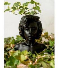 marilyn monroe. kobieta osłonka na rośliny.