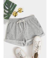 pantalones cortos de cintura con cordón y bolsillos laterales